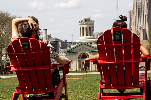 Students relax outside Hamerschlag Hall in chairs donated to the university.
