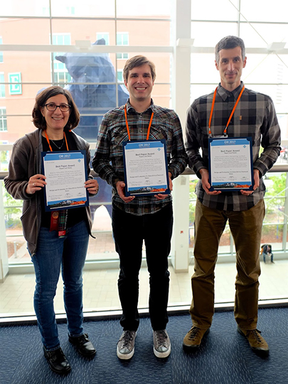 Lorrie Cranor, Blase Ur, and Lujo Bauer with their best paper awards.