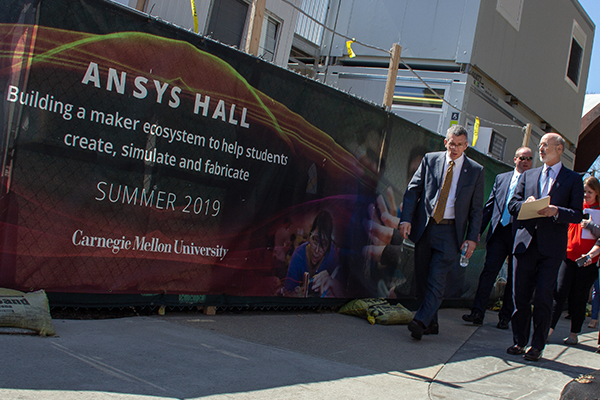 People walking in front of ANSYS Hall Sign