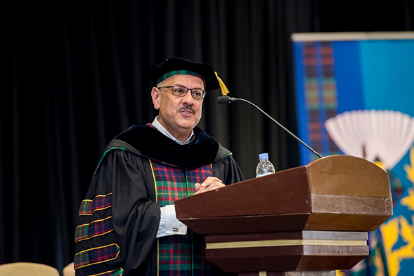 President Jahanian speaking at podium at graduation