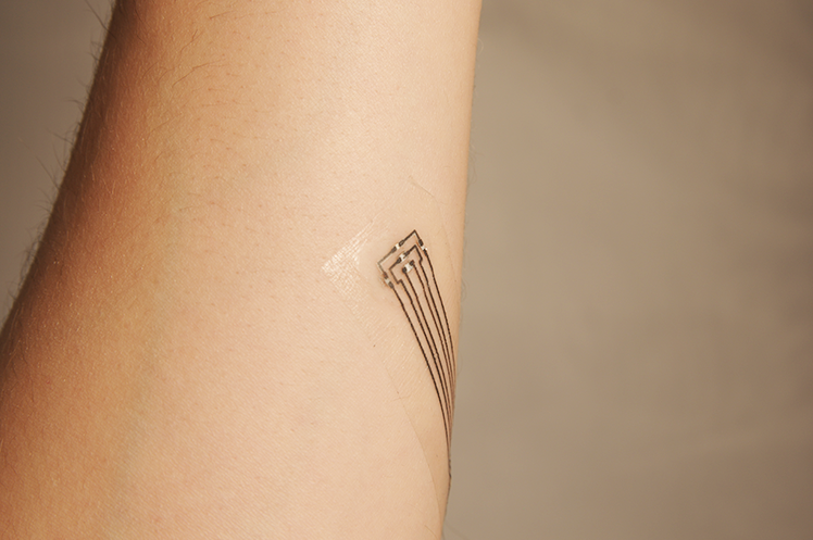 The ultrathin tattoos can be applied and removed easily with water, similar to decorative, temporary tattoos.