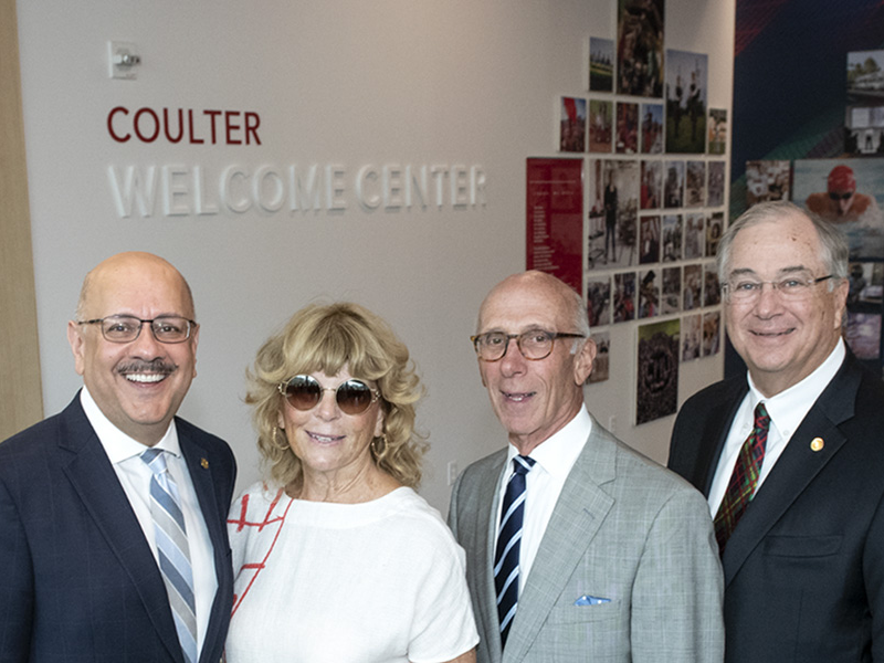 Group photo of Farnam Jahanian, Susan Coulter, David Coulter and James Rohr at the Coulter Welcome Center.