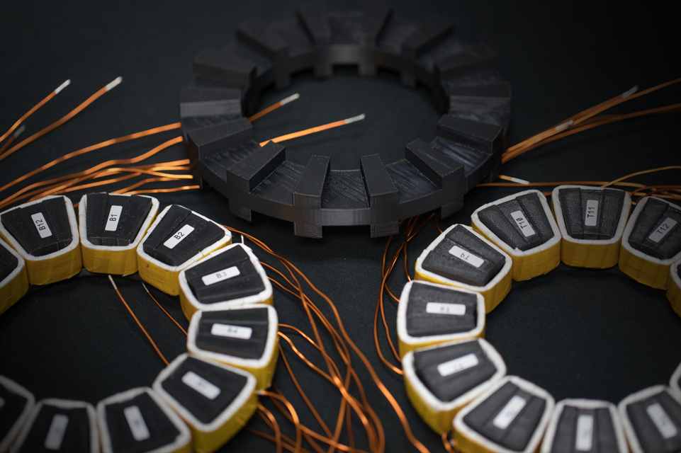 Circular motors on a black background with copper wires