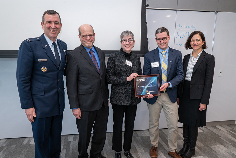 Jon Cagan, Liz Holm, Burcu Akinci, and a representative from the air force as well as another researcher holding the award.
