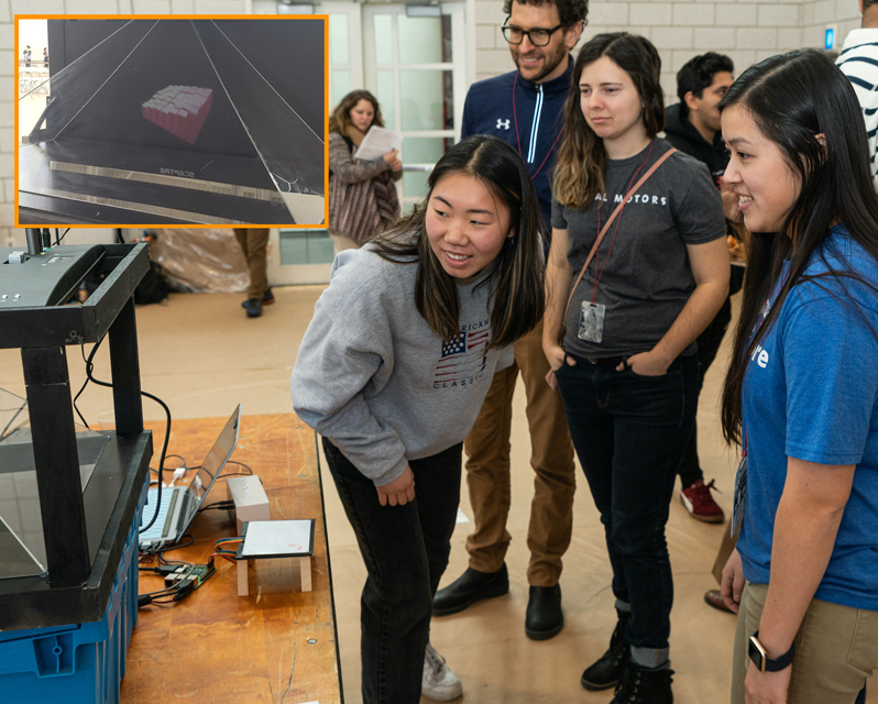 Group of students checking out a screen