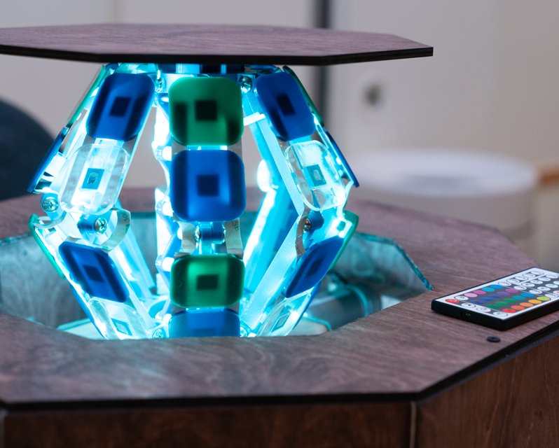 A lit-up claw raising the center of a table