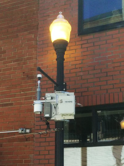 A lightpost with a sensor attached to it