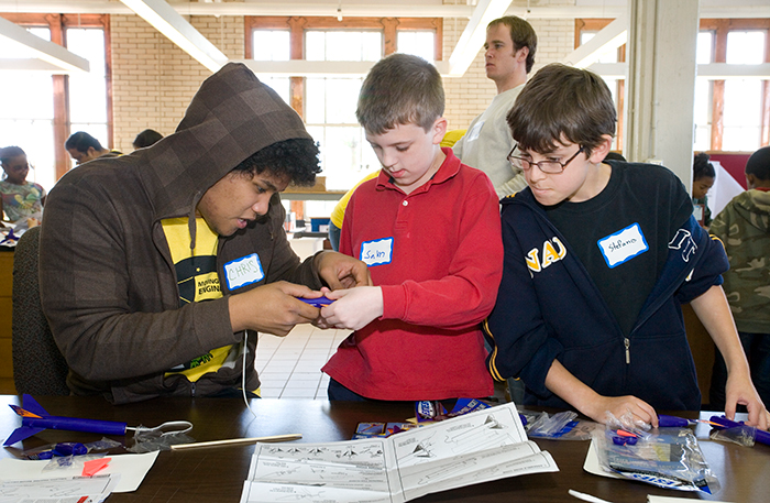 Three elementary school boys working on an engineering project.