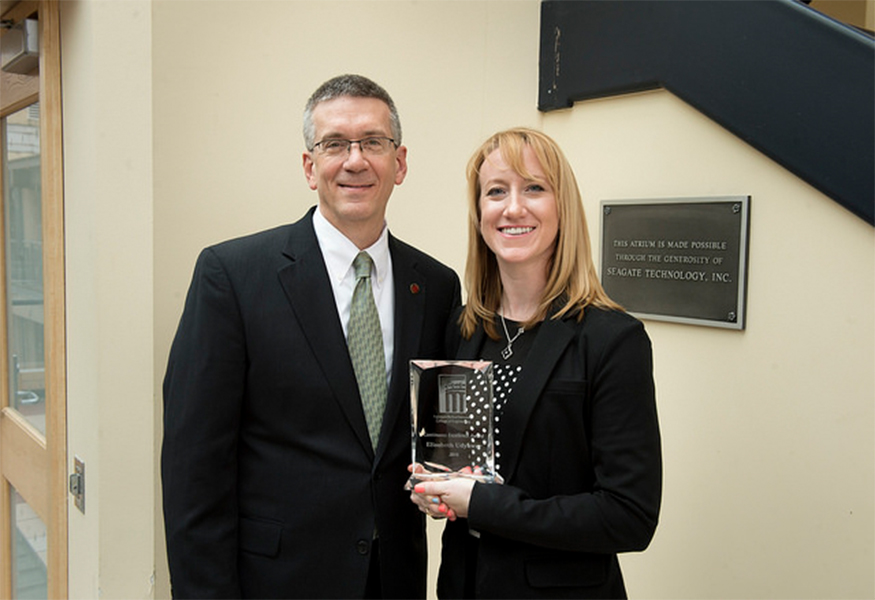 Continuous Excellence Award winner Elisabeth Udyawar with Dean Garrett