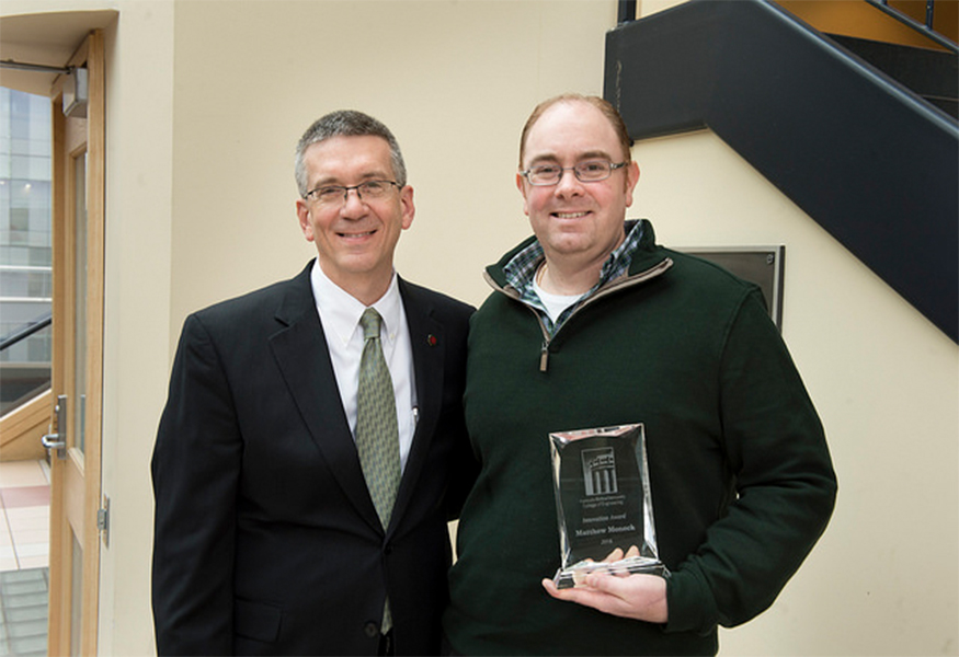 Innovation Award winner Matthew Moneck with Dean Garrett