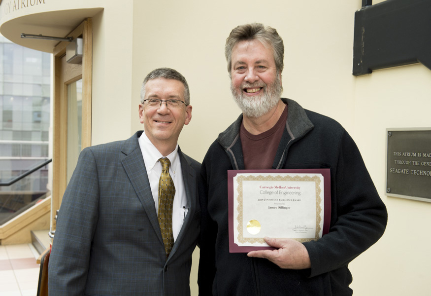 Continuous Excellence Award winner James Dillinger with Dean Garrett