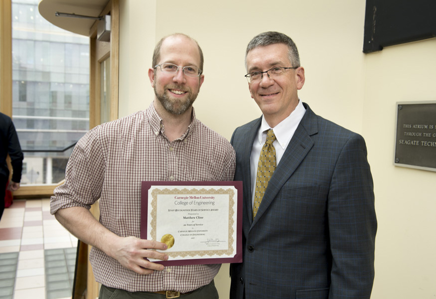 Years of Service Award winner Matthew Cline with Dean Garrett