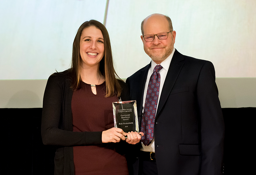 Continuous Excellence Award winner Beth Hockenberry (The Department of Civil and Environmental Engineering) with Interim Dean Jon Cagan.